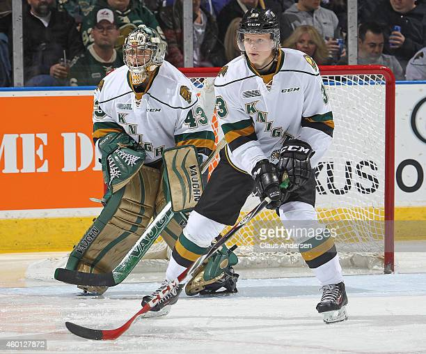 Julius Bergman and Michael Giugovaz of the London Knights watch for an incoming shot against the Sault Ste Marie Greyhounds in an OHL game at...
