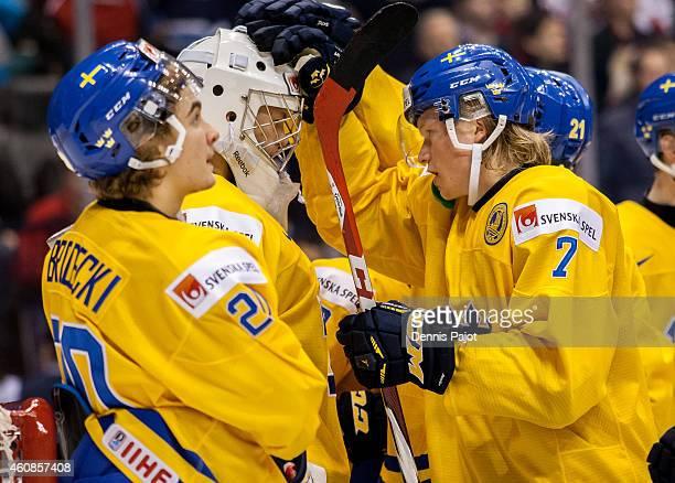 Julius Bergman congratulates goaltender Linus Soderstrom of Sweden of Denmark during the 2015 IIHF World Junior Championship on December 27 2014 at...