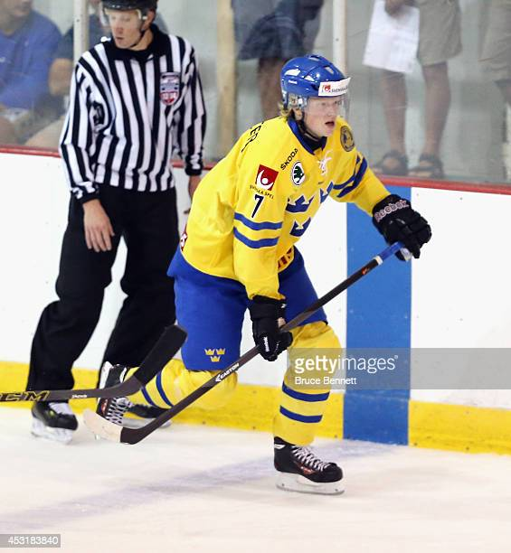 Julius Bergman of Team Sweden skates against USA Blue during the 2014 USA Hockey Junior Evaluation Camp at the Lake Placid Olympic Center on August 4...