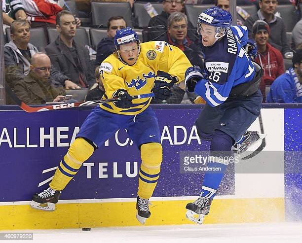 Julius Bergman of Team Sweden slams into Mikko Rantanen of Team Finland during a quarterfinal game in the 2015 IIHF World Junior hockey championship...
