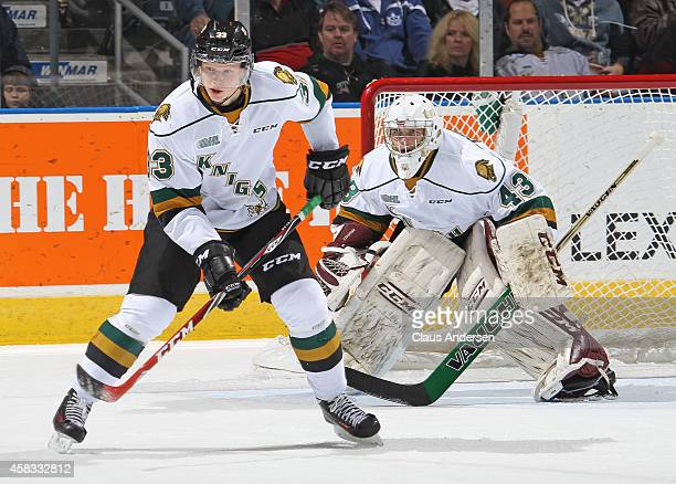 Julius Bergman of the London Knights defends in front of teammate Michael Giugovaz during play against the Sudbury Wolves in an OHL game at the...