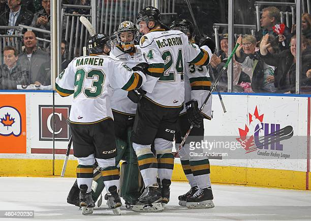 Julius Bergman of the London Knights is mobbed by his teammates after scoring a long empty net goal against the Plymouth Whalers in an OHL game at...