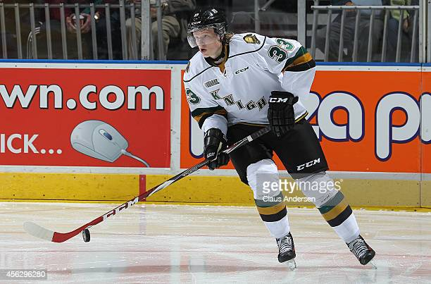 Julius Bergman of the London Knights skates with the puck against the Plymouth Whalers in an OHL game at the Budweiser Gardens on September 26 2014...