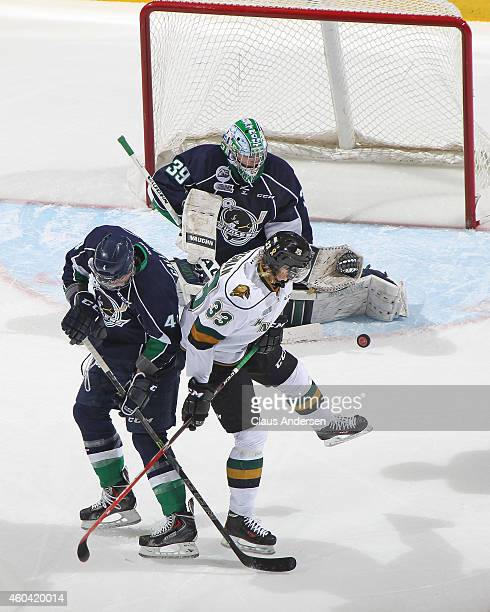 Julius Bergman of the London Knights tips a shot at Alex Nedeljkovic of the Plymouth Whalers in an OHL game at Budweiser Gardens on December 12 2014...