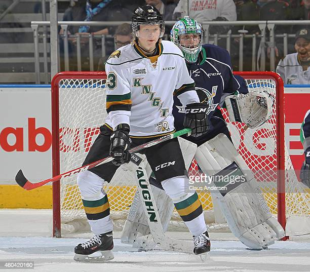 Julius Bergman of the London Knights waits to tip a shot at Alex Nedeljkovic of the Plymouth Whalers in an OHL game at Budweiser Gardens on December...