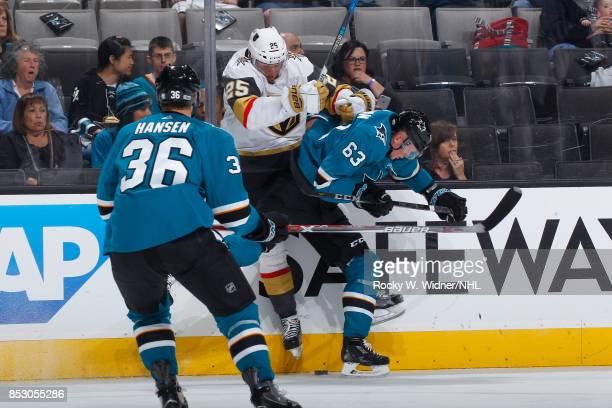 Julius Bergman of the San Jose Sharks checks Stefan Matteau of the Vegas Golden Knights into the boards at SAP Center on September 21 2017 in San...