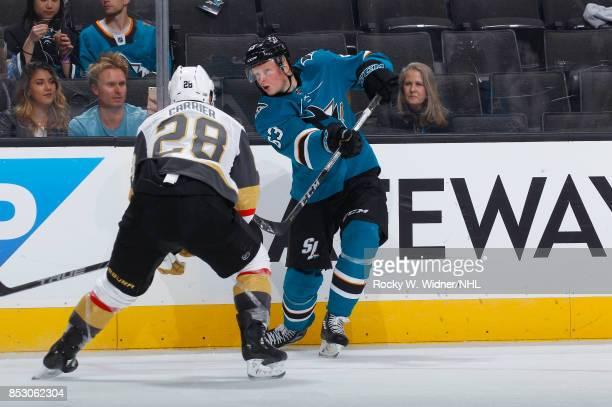 Julius Bergman of the San Jose Sharks passes the puck against William Carrier of the San Jose Sharks at SAP Center on September 21 2017 in San Jose...