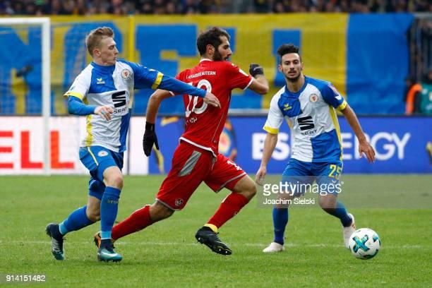 Julius Biada and Onur Bulut of Braunschweig challenges Halil Altintop of Kaiserslautern during the Second Bundesliga match between Eintracht...