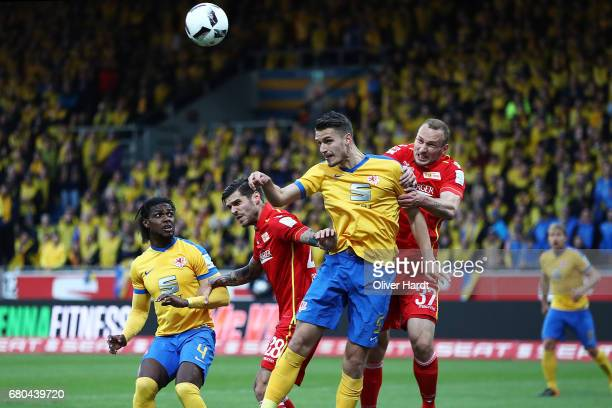 Julius Biada of Braunschweig and Toni Leistner of Berlin compete for the ball during the Second Bundesliga match between Eintracht Braunschweig and 1...