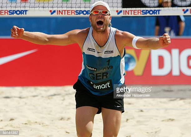 Julius Brink of Germany celebrates victory after winning the Bronze Medal Match between Kjell Schneider and Julius Brink of Germany against Marvin...