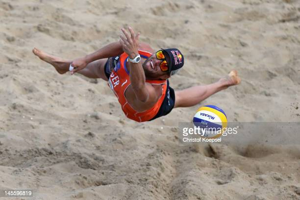 Julius Brink of Germany digs the ball during the men's semi final match between Michal Kadziola and Jakub Szalankiewicz of Poland and Julius Brink...