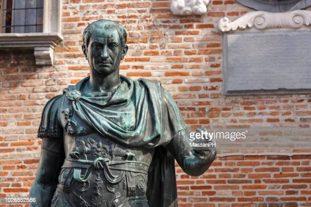 julius caesar bronze statue and part of the town hall façade and the dome bell tower - roman stock pictures, royalty-free photos & images