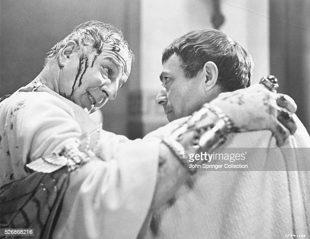Julius Caesar played by actor Louis Calhern bleeds as he is murdered by Brutus played by actor James Mason in the 1953 motion picture Julius Caesar