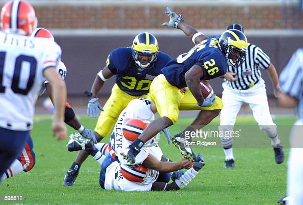 Julius Curry of Michigan leaps over Illinois defenders in Ann Arbor Michigan Michigan won the game 4520 DIGITAL PICTURE Mandatory Credit Tom...
