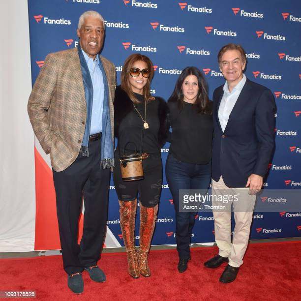 Julius 'Dr J' Erving and Dr Oz arrive to Michael Rubin's Fanatics Super Bowl Party at the College Football Hall of Fame on February 2 2019 in Atlanta...