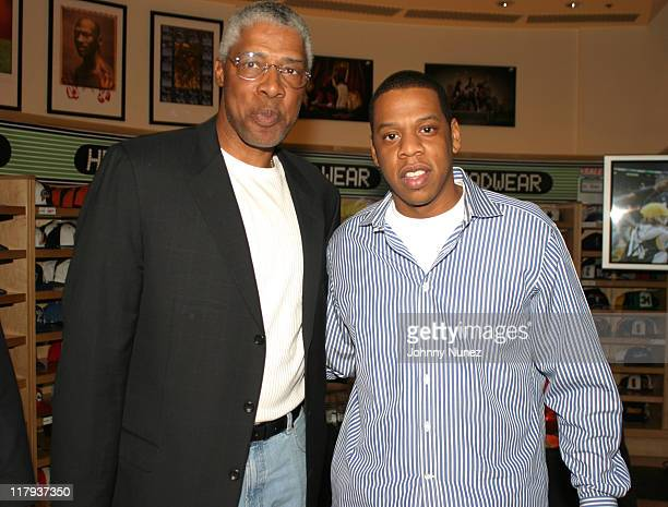 Julius Dr J Erving and JayZ during Got Milk NBA Rookie of the Year 2004 Presented to LeBron James at NBA Store in New York City New York United States
