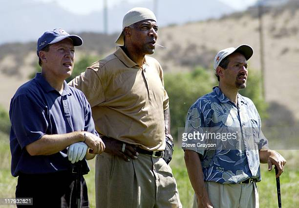 Julius 'Dr J' Erving and members of his playing group look on at the flight of shot