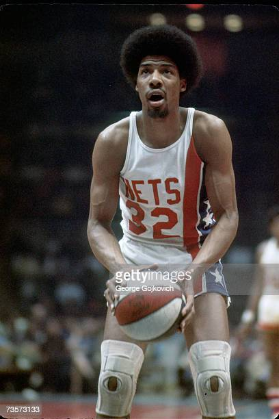 Julius Erving of the American Basketball Association New York Nets prepares to take a foul shot during a game at the Nassau Coliseum in March 1975 in...