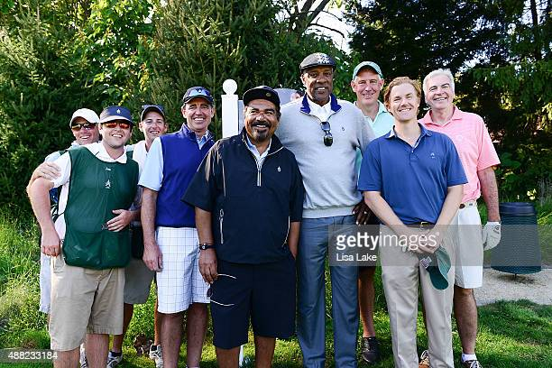 Julius Erving and George Lopez pose with other golfers at the Julius Erving Golf Classic at Aronimink Golf Club on September 14 2015 in Newtown...