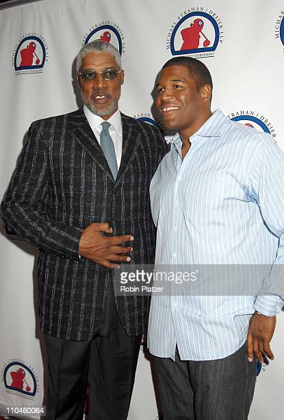 Julius Erving and Michael Strahan during Jon Bon Jovi and Michael Strahan Appearance at Tao Restaurant In New York City July 9 2006 at Tao Restaurant...
