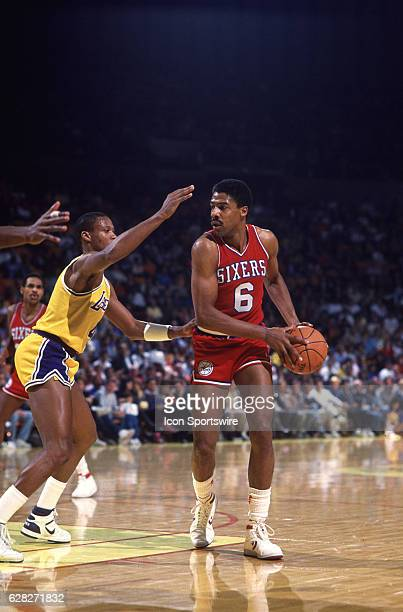 Julius Erving 'Dr J' #6 of the Philadelphia 76ers in action during a Sixers game versus the Los Angeles Lakers at the Great Western Forum in...