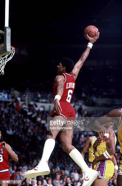 Julius Erving 'Dr J' of the Philadelphia 76ers goes up for the slam dunk during a Sixers game versus the Los Angeles Lakers at the Great Western...