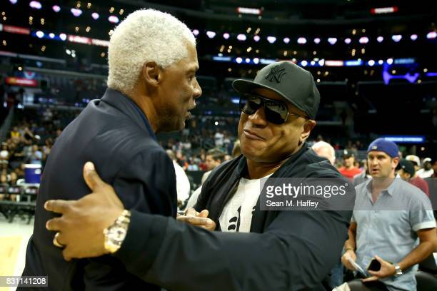 Julius Erving head coach of TriState greets LL Cool Jay before the game against Power during week eight of the BIG3 three on three basketball league...