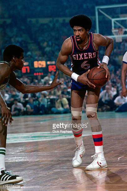Julius Erving looks to drive to the basket during a game played against the Boston Celtics circa 1977 at the Boston Garden in Boston Massachusetts...