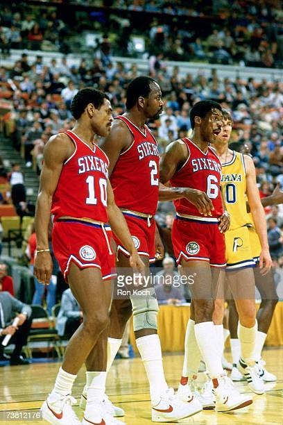 Julius Erving, Moses Malone and Maurice Cheeks of the Philadelphia 76ers take the court against the Indiana Pacers during an NBA game circa 1976-1987...