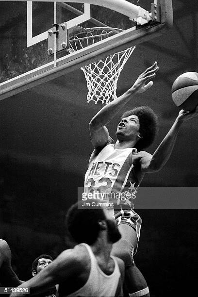 Julius Erving of the New York Nets drives to the basket during an ABA game in 1974 at the Nassau Coliseum in Uniondale New York NOTE TO USER User...