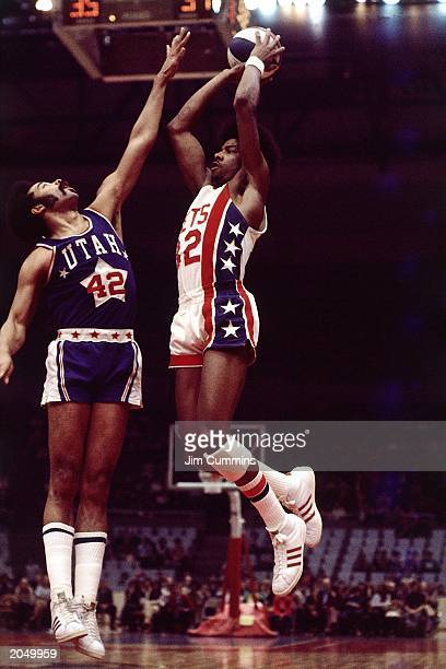 Julius Erving of the New York Nets shoots against the Utah Stars during an ABA game at the Nassau Veterans Memorial Coliseum in 1974 in Uniondale New...