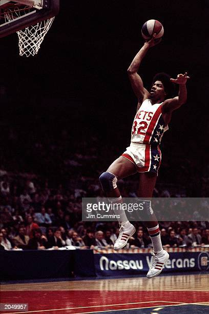 Julius Erving of the New York Nets soars to the basket during an ABA game at the Nassau Veterans Memorial Coliseum in 1974 in Uniondale New York NOTE...