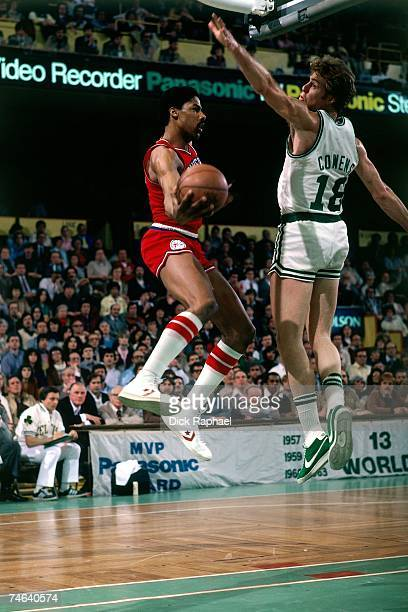Julius Erving of the Philadelphia 76ers attempts a layup against Dave Cowens of the Boston Celtics during a 1980 NBA game at the Boston Garden in...