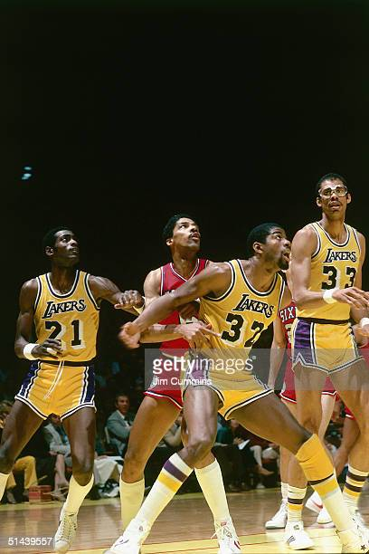 Julius Erving of the Philadelphia 76ers battles for rebound position against Magic Johnson of the Los Angeles Lakers during an NBA game at the Great...