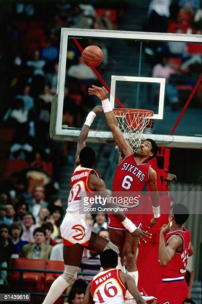 Julius Erving of the Philadelphia 76ers blocks a shot against the Atlanta Hawks during an NBA game ini 1984 at the Omni in Atlanta Georgia NOTE TO...