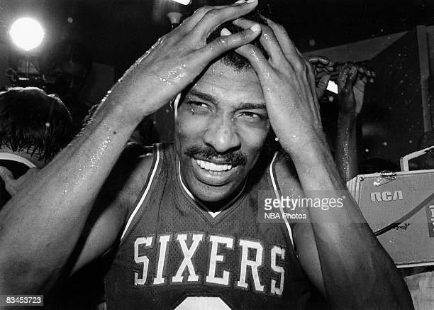 Julius Erving of the Philadelphia 76ers celebrates following Game Four of the NBA Finals played against the Los Angeles Lakers on May 31 1983 at the...
