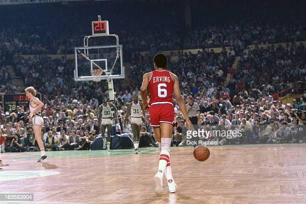 Julius Erving of the Philadelphia 76ers dribbles the ball against the Boston Celtics during a game played circa 1975 at the Boston Garden in Boston...