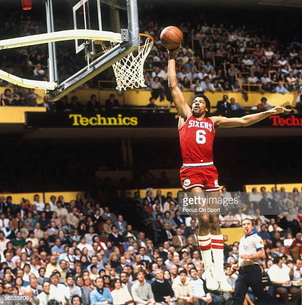 Julius Erving of the Philadelphia 76ers dunks circa the 1970's during a game