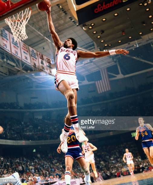 Julius Erving of the Philadelphia 76'ers goes for a dunk against the Denver Nuggets during the NBA game at the Spectrum in Philadelphia Pennsylvania...