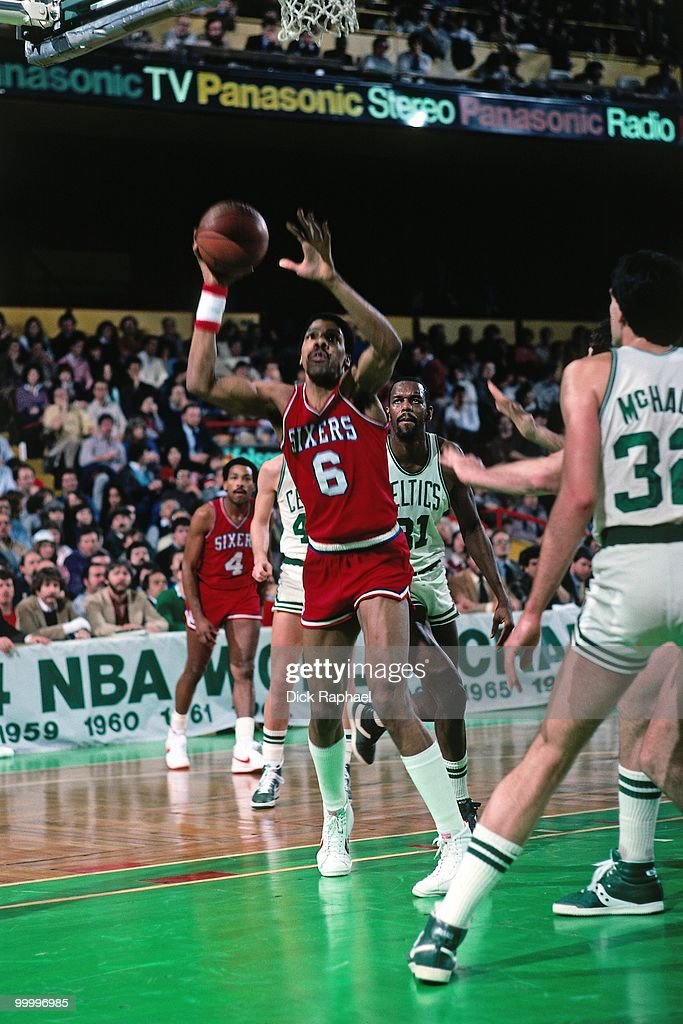 Julius Erving #6 of the Philadelphia 76ers goes up for a shot against Kevin McHale #32 of the Boston Celtics during a game played in 1983 at the Boston Garden in Boston, Massachusetts.