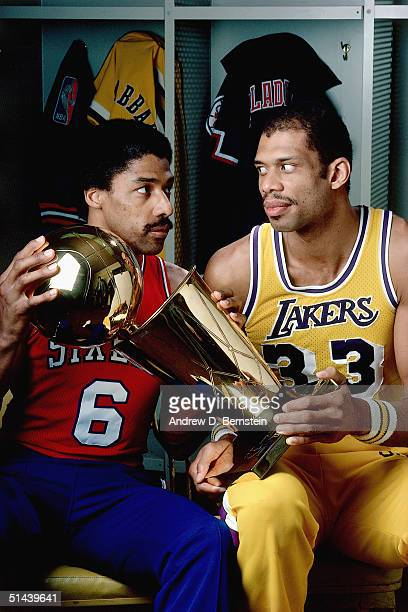 Julius Erving of the Philadelphia 76ers poses for a portrait in the locker room with Kareem Abdul-Jabbar of the Los Angeles Lakers during the 1982...