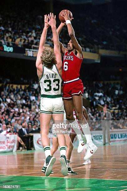 Julius Erving of the Philadelphia 76ers shoots against Larry Bird of the Boston Celtics during a game played circa 1984 at the Boston Garden in...