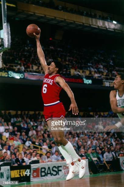 Julius Erving of the Philadelphia 76ers soars for a dunk against the Boston Celtics during a 1985 NBA game at the Boston Garden in Boston...