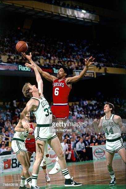 Julius Erving of the Philadelphia 76ers soars for a layup against Larry Bird of the Boston Celtics during a 1985 NBA game at the Boston Garden in...