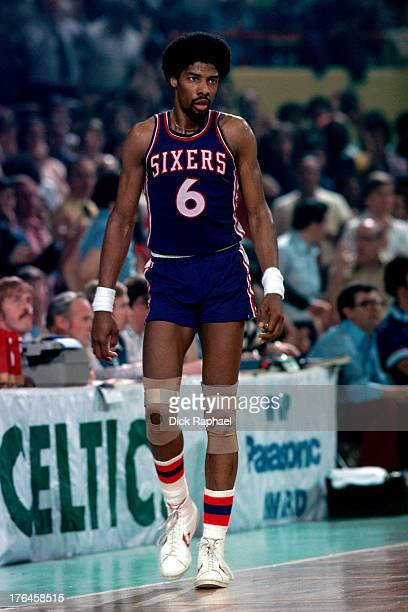 Julius Erving of the Philadelphia 76ers walks on to the court during a game against the Boston Celtics played circa 1977 at the Boston Garden in...