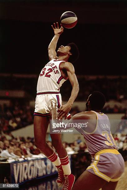 Julius Erving of the Virginia Squires grabs a rebound during an ABA game in 1972 in Virginia NOTE TO USER User expressly acknowledges and agrees that...