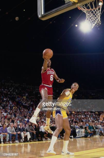 Julius Erving, Small Forward for the Philadelphia 76ers makes a one handed lay up to the basket over Kareem Abdul-Jabbar, Center for the Los Angeles...