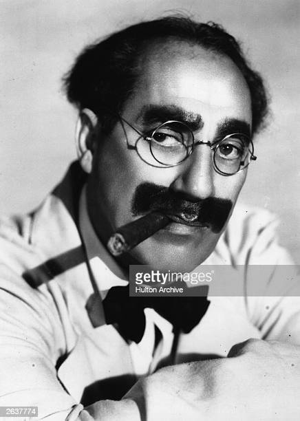 Julius 'Groucho' Marx one of the Marx brothers an American comic group