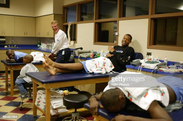 Julius Hodge Marcus Camby Earl Boykins and athletic trainer Jim Gillen of the Denver Nuggets talk before practice at the Pepsi Center on December 22...