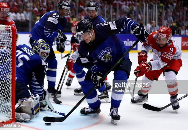 Julius Honka of Finland and Frederik Storm of Denmark battle for the puck during the 2018 IIHF Ice Hockey World Championship group stage game between...